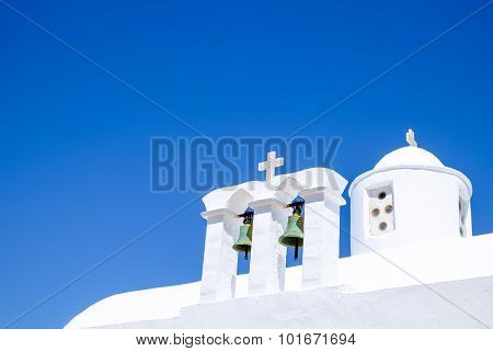 Detail View Of Bells And Roof Of Traditional Greek Cycladic Church