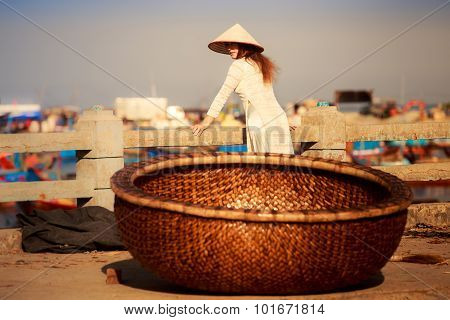 View Of Vietnam Fishing Basket Against Blonde Girl In National