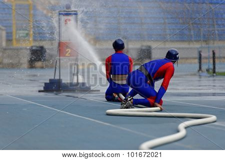 ST. PETERSBURG, RUSSIA - SEPTEMBER 9, 2015: Team Mongolia during competitions in combat deployment during the XI World Championship in Fire and Rescue Sport. First World Championship was held in 2002