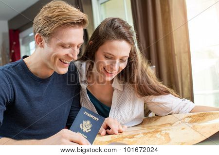 Young couple planning a trip together