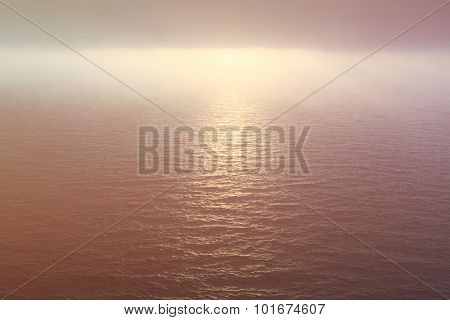 Ocean water and foggy sky at sunset in Atlantic