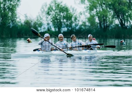 four athlete in a kayak