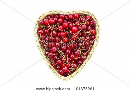 Ripe Cherries In Heart Shaped Wicker Basket Isolated On White