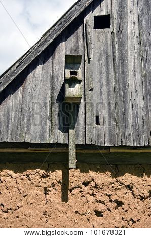Bird House On Old Clay And Wood Building