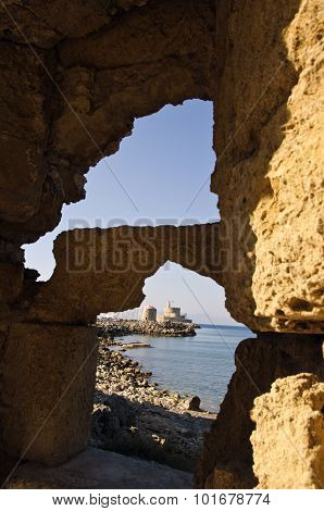 Fortress Seen Through The Holes In Cliffs In Rhodes Island