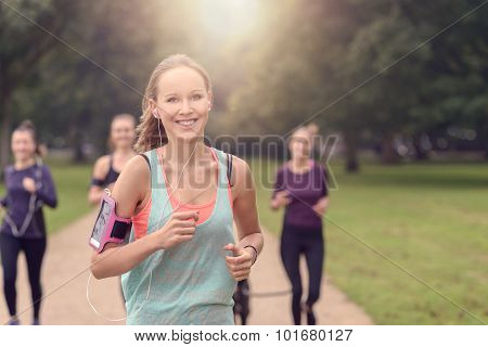 Pretty Woman Jogs In The Park With Other Girls