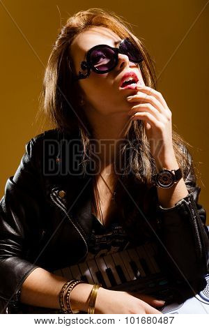 Elegant surprized young woman  in black leather jacket loking up