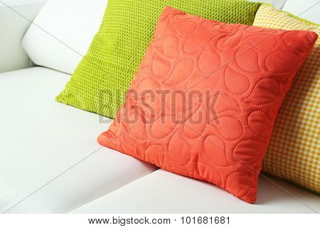 Colorful pillows on sofa, close-up