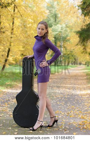 Girl With A Guitar Case