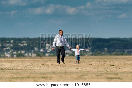 UKRAINE, KHARKIV -AUGUST 24: father and son on a fiel for airshow on Ukraine Independence Day at Kharkiv  on August 24, 2015