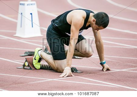 Man athlete in starting position