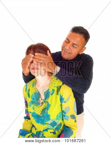 Man Holding His Hands On Wife's Eye's.
