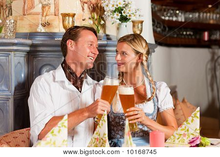 Bavarian Couple drinking wheat beer