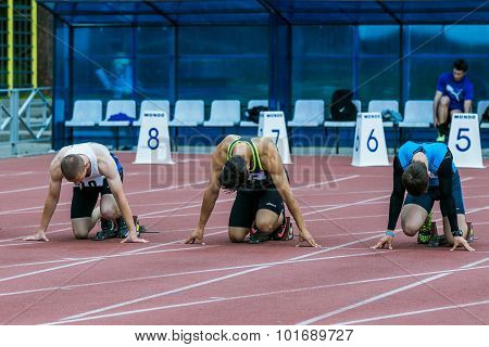 sprinters on the start line 100 m