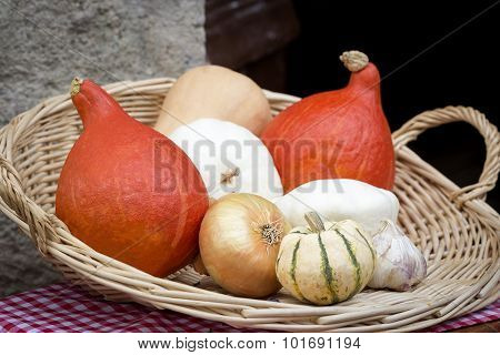Pumkins and onion in a basket