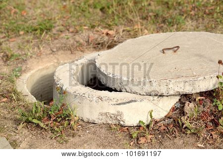 Exposed concrete manhole