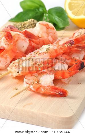 Shrimps, Olives, Lemon, And Basil On Board Isolated On White Background