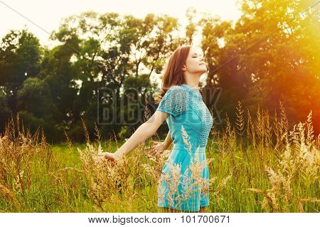 Enjoyment. Free Happy Woman Enjoying Nature. Beauty Girl Outdoor. Freedom Concept. Beauty Girl Over