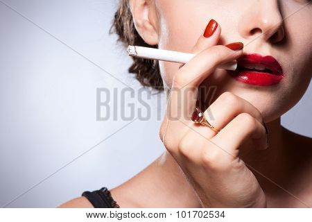 Close up portrait sexy young adult smoking a cigarette