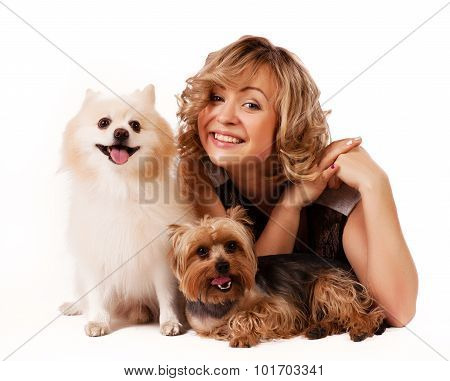 Cute young woman cuddling her dog while sitting isolated on white - portrait