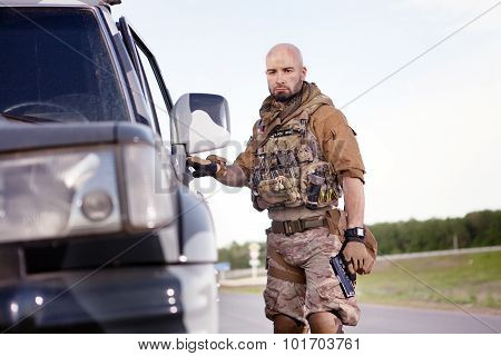 Soldier With The Gun In American Uniform Near Military Suv.