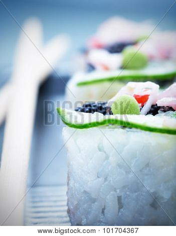 Sushi, soft focus, shallow dof, traditional asian food, luxury nutrition, served with wooden chopsticks, healthy lifestyle concept