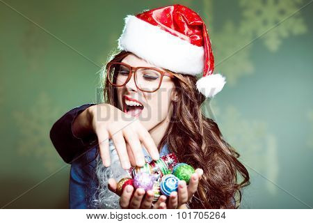 Funny hipster girl in glasses biting intruders hand having fun