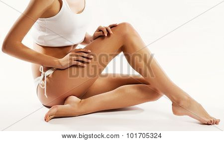 Young beautiful woman in cotton underwear sitting on white background