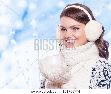 winter people happiness drink and fast food concept - woman in hat with takeaway tea or coffee cup