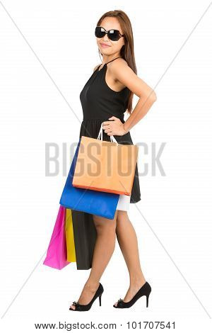 Asian Female Shopper Standing Akimbo Full Profile