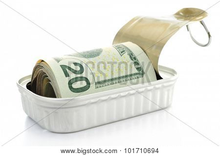 a wad of US dollar bills in a can on a white background
