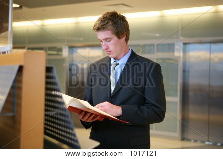 Business Man Studying In Library