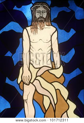 RIJEKA, CROATIA - JUNE 11: 10th Stations of the Cross, Jesus is stripped of His garments, stained-glass window in the church of St. John the Baptist in Rijeka, Croatia, on June 11, 2011