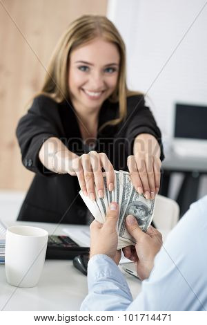 Woman Taking Batch Of Hundred Dollar Bills