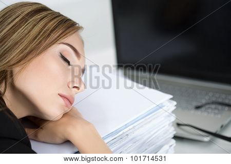Tired Business Woman Slleeping On Heap Of Papers