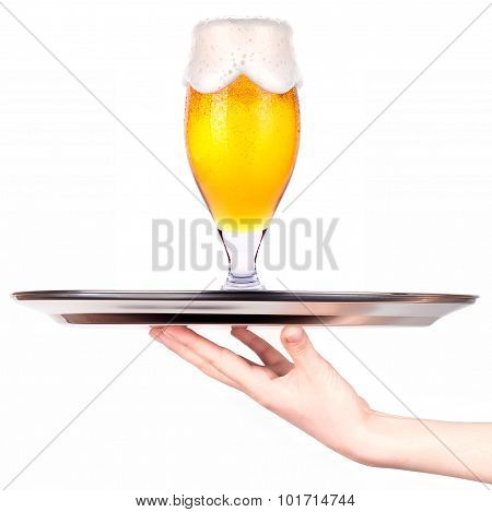Waitresses holding tray with light beer isoalted