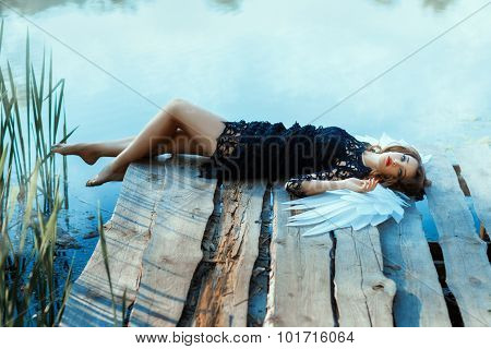 Angel Girl Lying On The Pier.