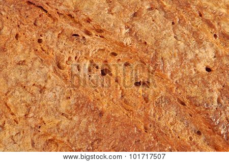 Close-up of bread crust. Texture for pattern and background.