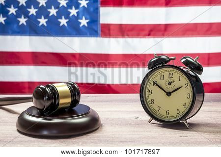 Gavel and Alarm Clock, American flag background