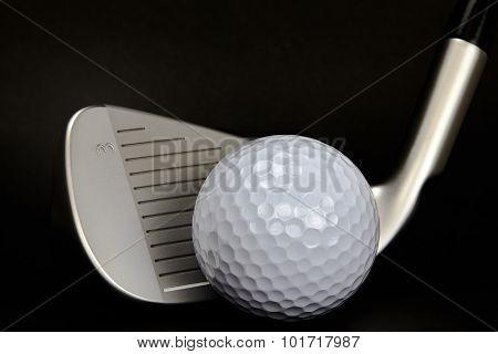 Golf Ball And Club Closeup On Black Background
