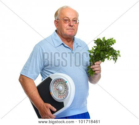 Elderly man with scales and parsley isolated over white background.