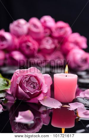 bouquet rose petals with candle and therapy stones