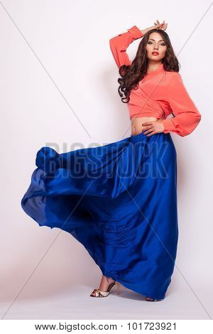Fashion Photo Of Young Magnificent Woman In Blue Dress. Studio Photo