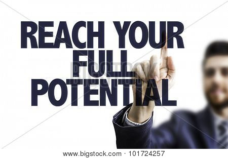 Business man pointing the text: Reach Your Full Potential