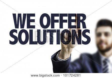 Business man pointing the text: We Offer Solutions