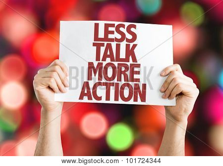 Less Talk More Action placard with bokeh background