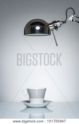 Lighting Up White Mug Coffee Cup With Desk Lamp