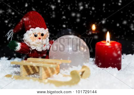 Santa With Sledge In The Snow