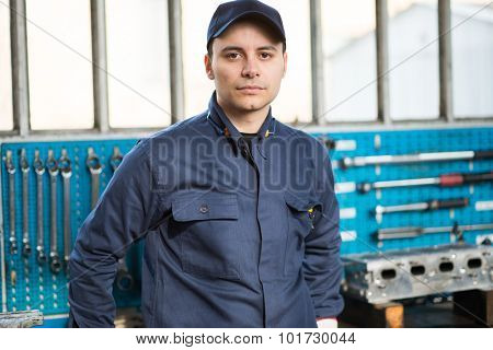 Young mechanic in his shop