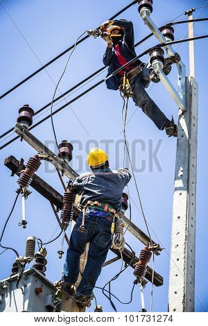 Electricians Working On Electricity Pole To Replace